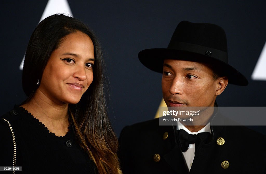 Singer Pharrell Williams (R) and fashion designer Helen Lasichanh arrive at the Academy of Motion Picture Arts and Sciences' 8th Annual Governors Awards at The Ray Dolby Ballroom at Hollywood & Highland Center on November 12, 2016 in Hollywood, California.