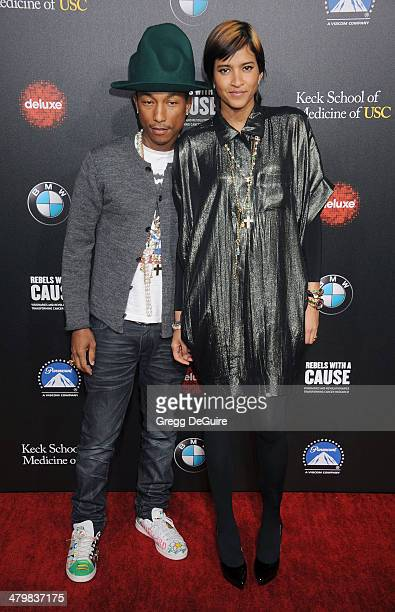 Singer Pharrell Williams and Helen Lasichanh arrive at the 2nd Annual Rebel With A Cause Gala at Paramount Studios on March 20 2014 in Hollywood...