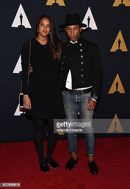 Singer Pharrell Williams and Helen Lasichanh arrive at the Academy of Motion Picture Arts and Sciences' 8th Annual Governors Awards at The Ray Dolby...