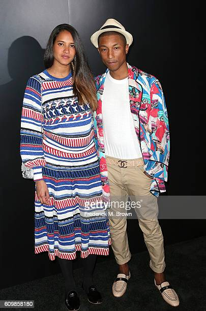 Singer Pharrell Williams and Helen Lasichanh attend Chanel Dinner Celebrating N 5 L'Eau at the Sunset Tower Hotel on September 22 2016 in West...