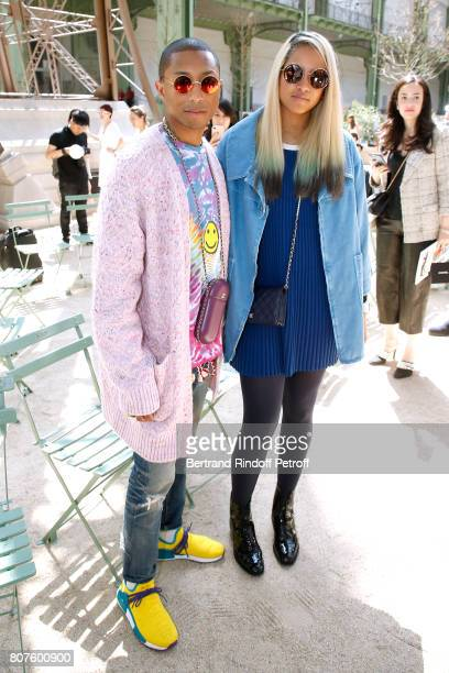 Singer Pharrell Williams and Helen Lasichanh attend the Chanel Haute Couture Fall/Winter 20172018 show as part of Haute Couture Paris Fashion Week on...