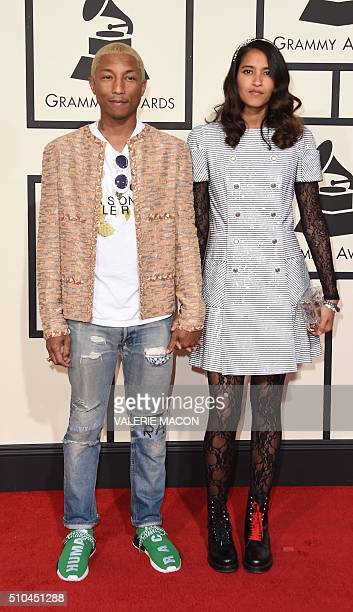 Singer Pharrell Williams and his wife Helen Lasichahn arrive on the red carpet during the 58th Annual Grammy Music Awards in Los Angeles February 15...