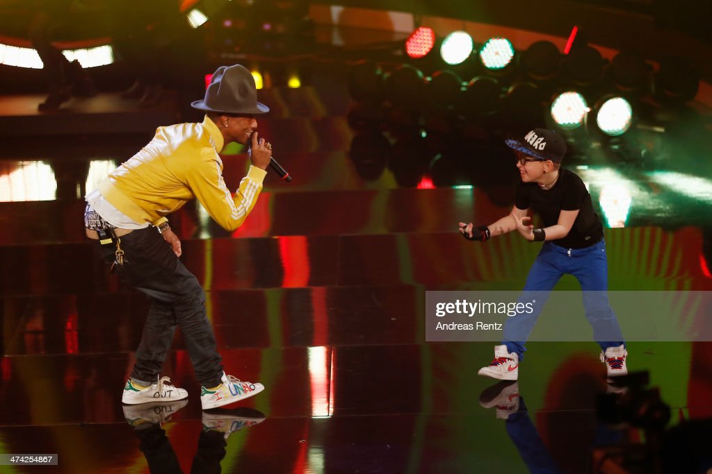Singer Pharrell Williams and Leandro Palme perform on stage during the 'Wetten, dass..?' TV Show from Dusseldorf at the ISS Dome on February 22, 2014 in Duesseldorf, Germany..