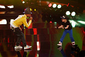 Singer Pharrell Williams and Leandro Palme perform on stage during the 'Wetten dass' TV Show from Dusseldorf at the ISS Dome on February 22 2014 in...