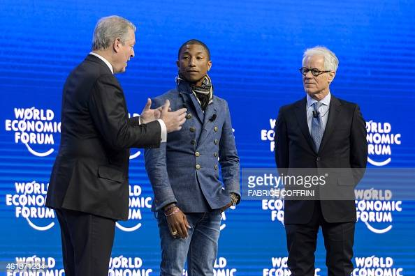 US singer Pharrell Williams and Live Earth founder Kevin Wall listen to Former US Vice President Al Gore during a session of the World Economic Forum...