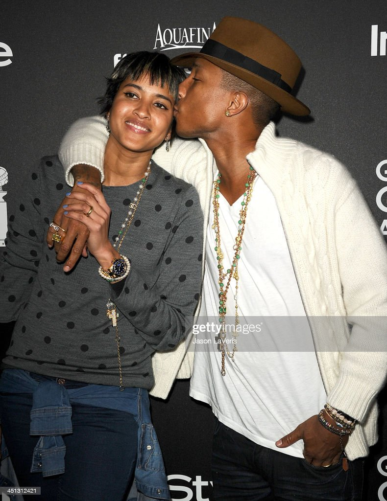 Singer <a gi-track='captionPersonalityLinkClicked' href=/galleries/search?phrase=Pharrell+Williams&family=editorial&specificpeople=161396 ng-click='$event.stopPropagation()'>Pharrell Williams</a> (R) and wife Helen Lasichanh attend the Miss Golden Globe event at Fig & Olive Melrose Place on November 21, 2013 in West Hollywood, California.