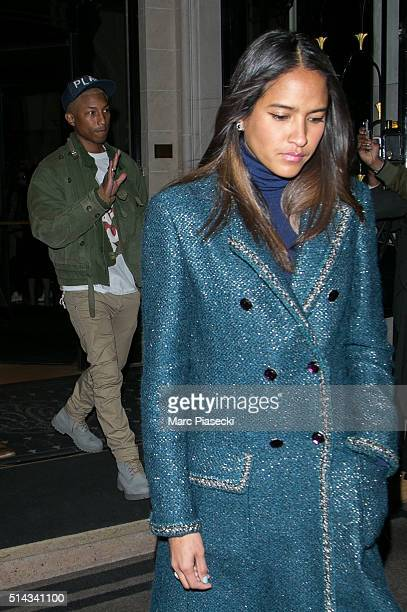 Singer Pharrell Williams and wife Helen Lasichanh leave the 'Four Seasons George ' hotel on March 8 2016 in Paris France