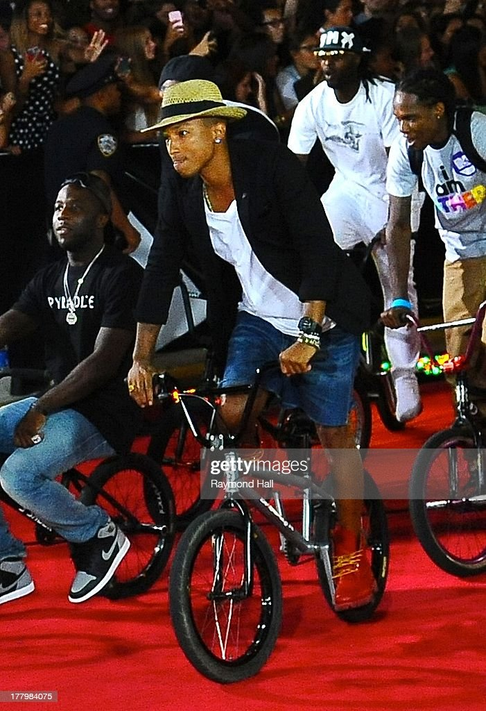 Singer <a gi-track='captionPersonalityLinkClicked' href=/galleries/search?phrase=Pharrell+Williams&family=editorial&specificpeople=161396 ng-click='$event.stopPropagation()'>Pharrell Williams</a> is seen at the 'VMA' on is bike on August 25, 2013 in New York City.