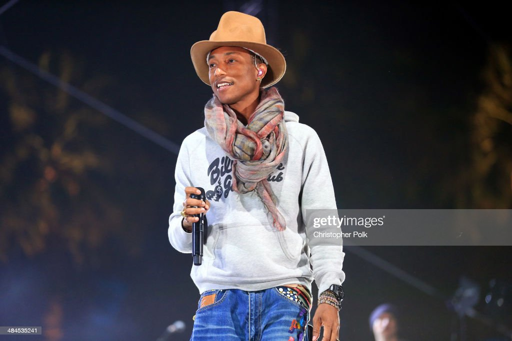 Singer Pharrell Williams performs onstage during day 2 of the 2014 Coachella Valley Music & Arts Festival at the Empire Polo Club on April 12, 2014 in Indio, California.