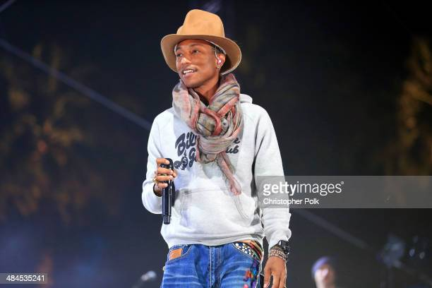 Singer Pharrell Williams performs onstage during day 2 of the 2014 Coachella Valley Music Arts Festival at the Empire Polo Club on April 12 2014 in...