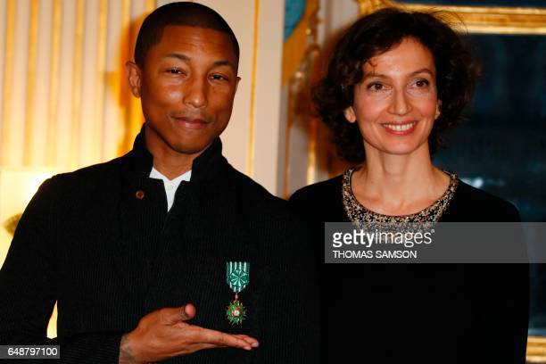 US singer Pharrell Williams poses after being awarded the Order of Arts and Letters Medal by French Culture Minister Audrey Azoulay in Paris on March...