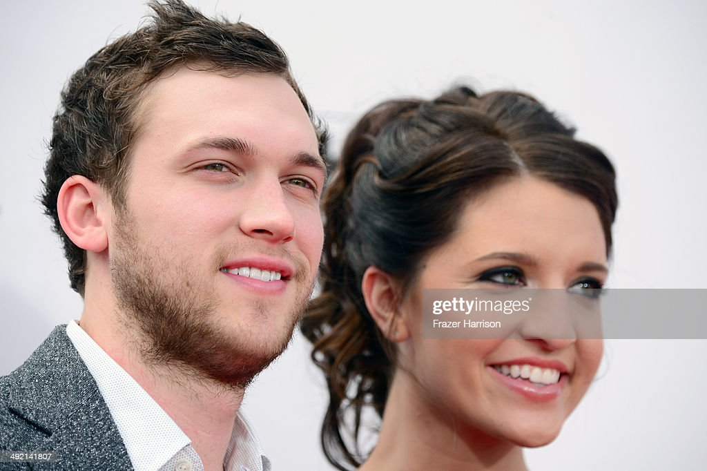 Singer <a gi-track='captionPersonalityLinkClicked' href=/galleries/search?phrase=Phillip+Phillips&family=editorial&specificpeople=1651494 ng-click='$event.stopPropagation()'>Phillip Phillips</a> (L) and Hannah Blackwell attend the 2014 Billboard Music Awards at the MGM Grand Garden Arena on May 18, 2014 in Las Vegas, Nevada.