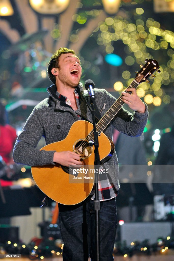 Singer Phillip Phillips performs at A Hollywood Christmas Celebration at The Grove on November 11, 2012 in Los Angeles, California.