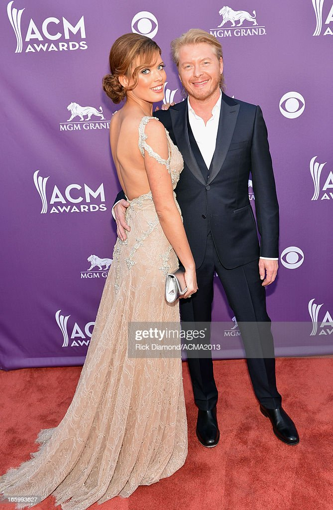Singer Phillip Sweet (R) of Little Big Town and Rebecca Sweet attend the 48th Annual Academy of Country Music Awards at the MGM Grand Garden Arena on April 7, 2013 in Las Vegas, Nevada.