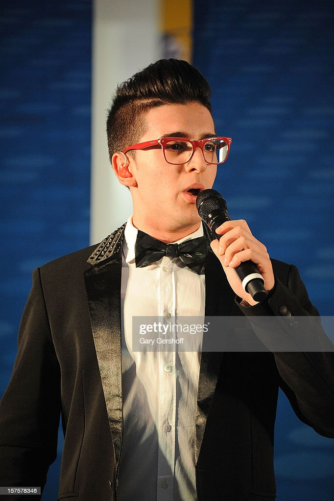 Singer Piero Barone of ll Volo performs at jetBlue Terminal 5 at JFK Airport on December 4, 2012 in New York City.