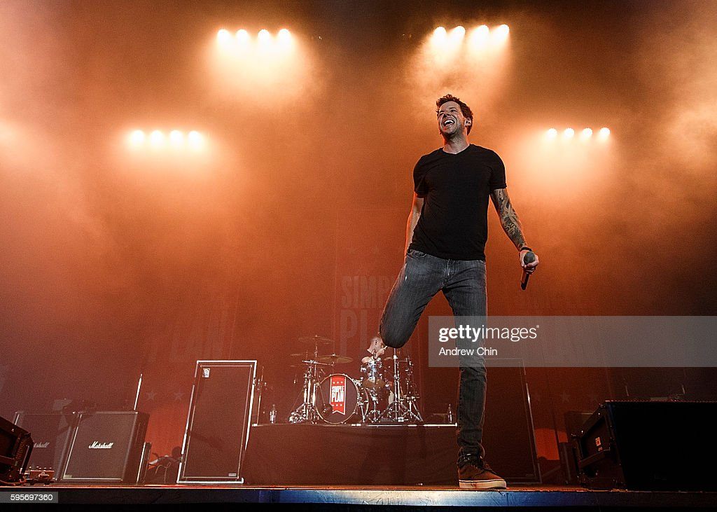Singer Pierre Bouvier of FrenchCanadian pop punk band Simple Plan performs onstage during PNE Summer Night Concert Series at PNE Amphitheatre on...