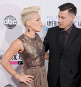 Singer Pink and Carey Hart arrive at the 40th Anniversary American Music Awards at Nokia Theatre LA Live on November 18 2012 in Los Angeles California