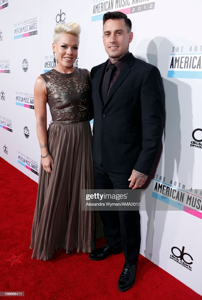 Singer Pink and <a gi-track='captionPersonalityLinkClicked' href=/galleries/search?phrase=Carey+Hart&family=editorial&specificpeople=696730 ng-click='$event.stopPropagation()'>Carey Hart</a> attend the 40th American Music Awards held at Nokia Theatre L.A. Live on November 18, 2012 in Los Angeles, California.