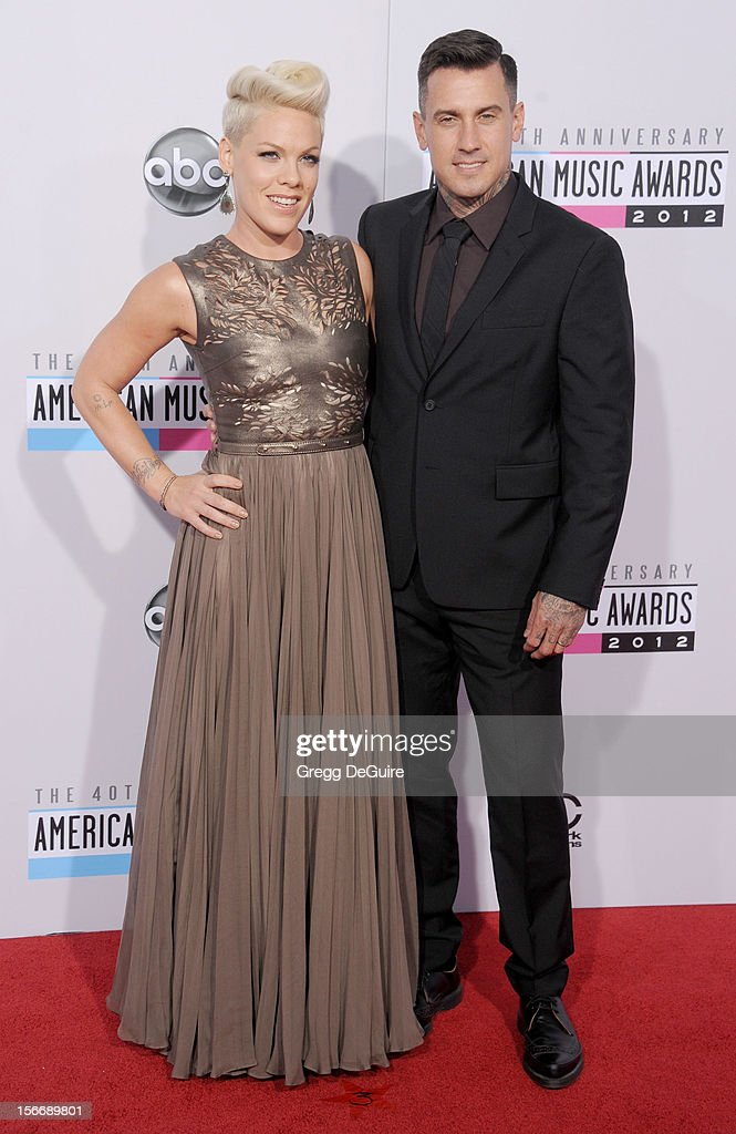 Singer Pink and husband Carey Hart arrive at the 40th Anniversary American Music Awards at Nokia Theatre LA Live on November 18 2012 in Los Angeles...