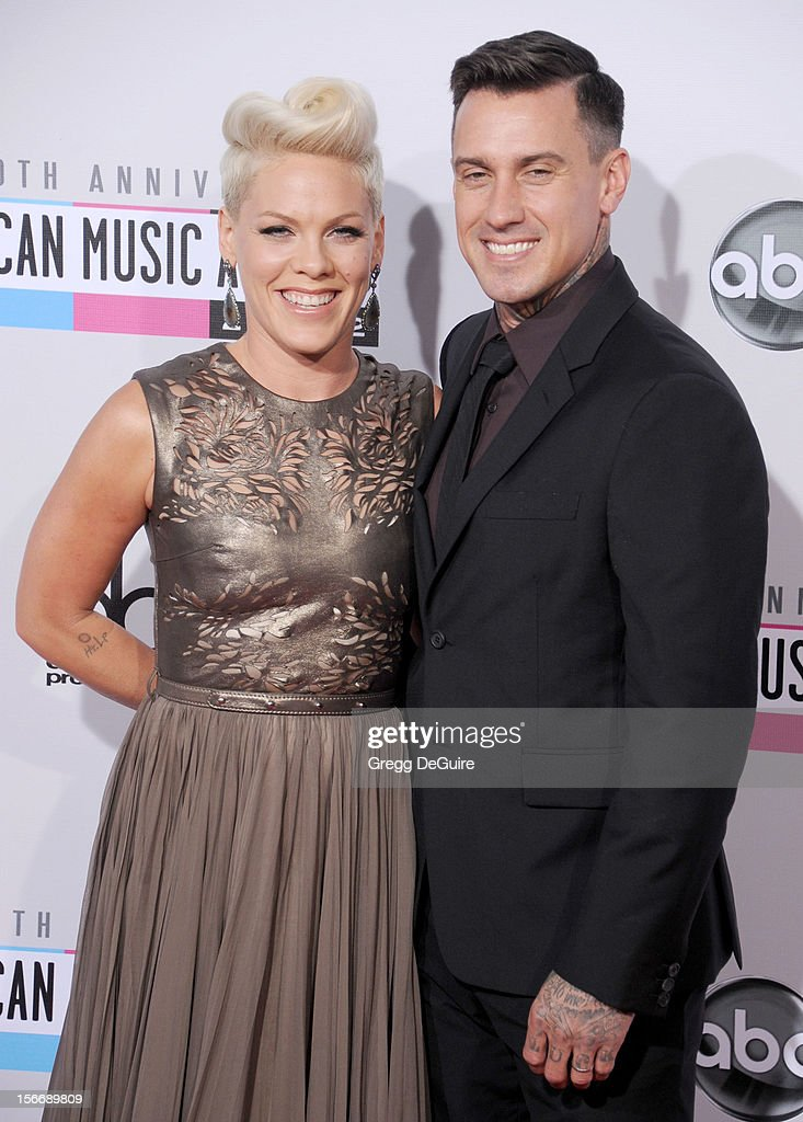 Singer Pink and husband <a gi-track='captionPersonalityLinkClicked' href=/galleries/search?phrase=Carey+Hart&family=editorial&specificpeople=696730 ng-click='$event.stopPropagation()'>Carey Hart</a> arrive at the 40th Anniversary American Music Awards at Nokia Theatre L.A. Live on November 18, 2012 in Los Angeles, California.