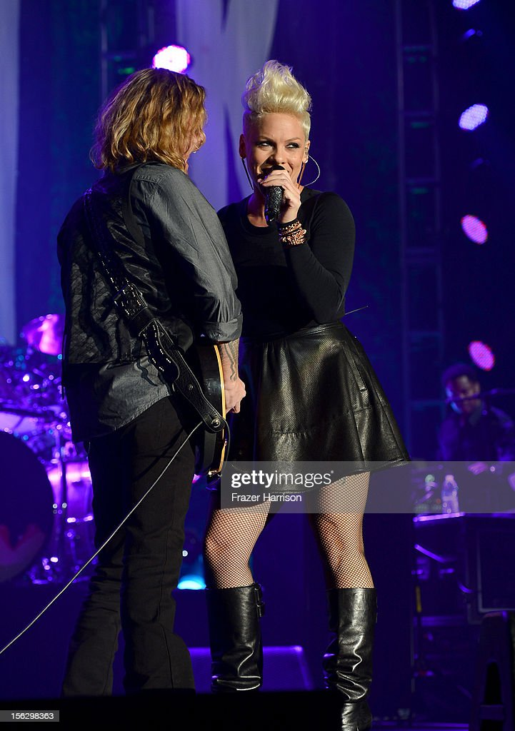 Singer Pink (R) performs onstage at the St. John's Health Center's Power Of Pink benefiting The Margie Petersen Breast Center at Sony Studios on November 12, 2012 in Los Angeles, California.