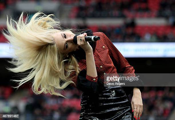 Singer Pixie Lott performs at halftime during the Aviva Premiership match between Saracens and Harlequins at Wembley Stadium on March 28 2015 in...