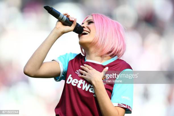 Singer Pixie Lott performs during the Premier League match between West Ham United and Everton at the London Stadium on April 22 2017 in Stratford...