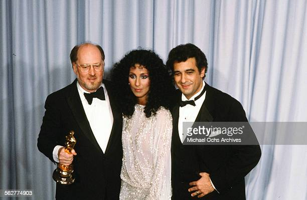Singer Placido Domingo and Cher pose with Composer John Williams after winning 'Best Original Score' during the 55th Academy Awards at Dorothy...