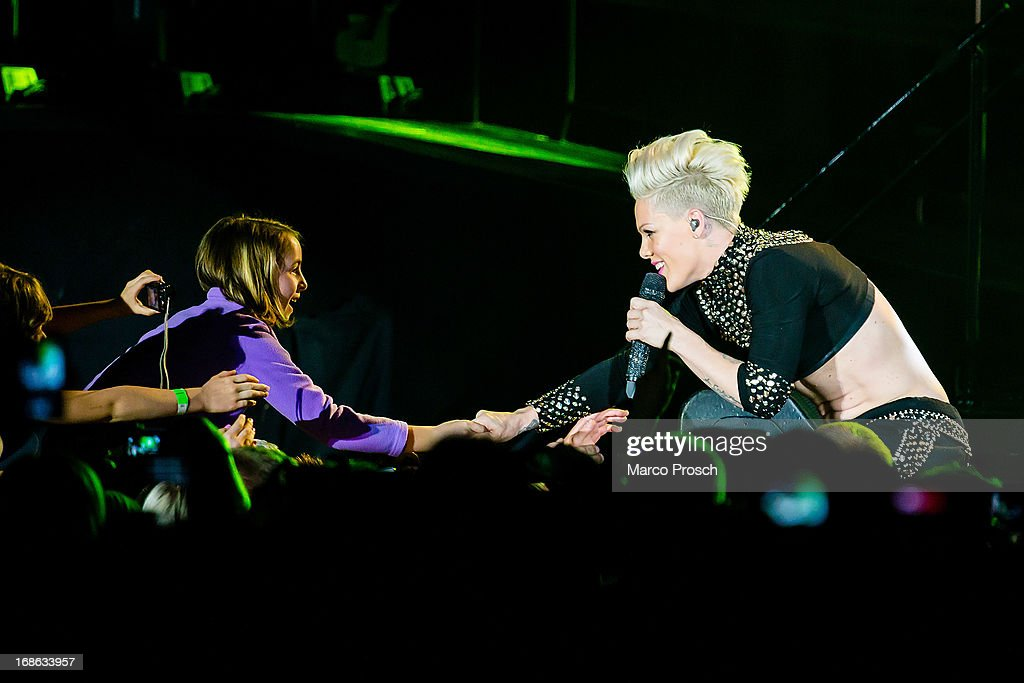 Singer P!nk greets a fan whilst performing live at the Arena Leipzig on May 12, 2013 in Leipzig, Germany.