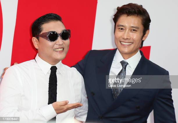 Singer Psy and actor Byunghun Lee attend the premiere of Summit Entertainment's 'RED 2' at Westwood Village on July 11 2013 in Los Angeles California