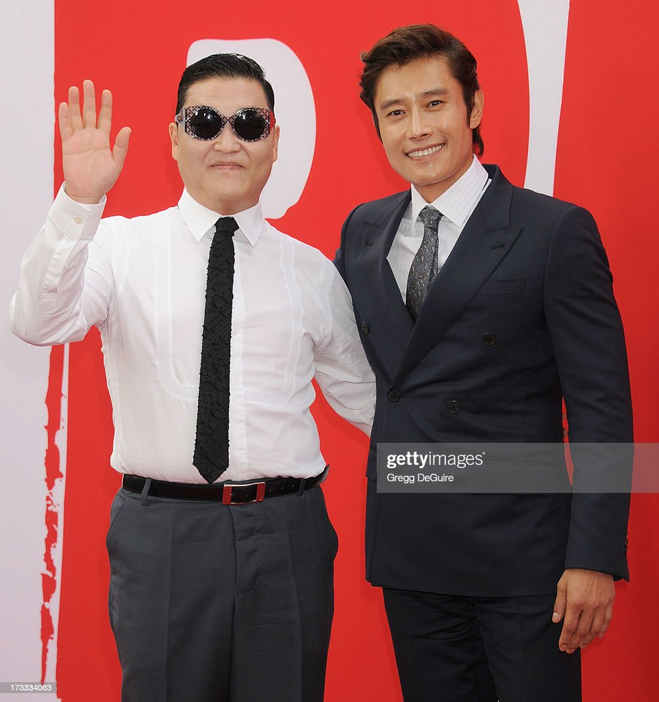 Singer PSY and singer Byung-hun Lee arrive at the Los Angeles premiere of 'Red 2' at Westwood Village on July 11, 2013 in Los Angeles, California.