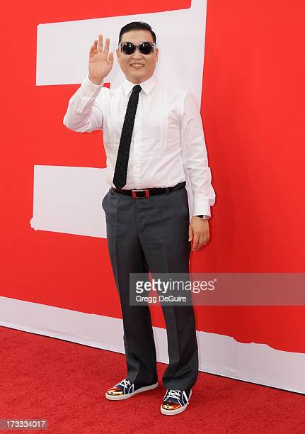 Singer PSY arrives at the Los Angeles premiere of 'Red 2' at Westwood Village on July 11 2013 in Los Angeles California