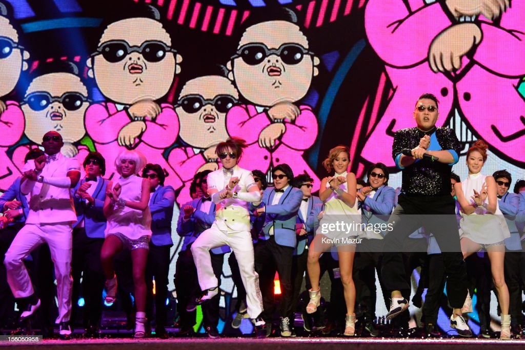 Singer Psy (2R) performs 'Gangnam Style' onstage during the MTV EMA's 2012 at Festhalle Frankfurt on November 11, 2012 in Frankfurt am Main, Germany.