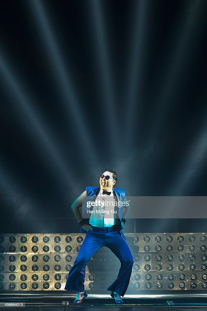 Singer PSY performs on stage during '2013 PSY Concert All Night Stand' at Olympic Stadium on December 22, 2013 in Seoul, South Korea.