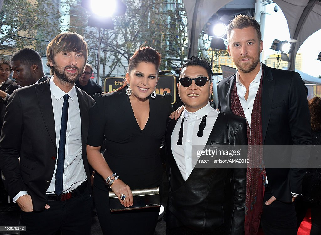 Singer Psy (2nd from R) with Lady Antebellum singers <a gi-track='captionPersonalityLinkClicked' href=/galleries/search?phrase=Dave+Haywood&family=editorial&specificpeople=4620526 ng-click='$event.stopPropagation()'>Dave Haywood</a>, Hillary Scott and <a gi-track='captionPersonalityLinkClicked' href=/galleries/search?phrase=Charles+Kelley&family=editorial&specificpeople=3935435 ng-click='$event.stopPropagation()'>Charles Kelley</a> at the 40th American Music Awards held at Nokia Theatre L.A. Live on November 18, 2012 in Los Angeles, California.