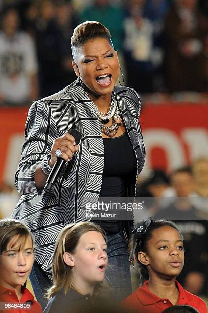 Singer Queen Latifah performs onstage during the Super Bowl XLIV Pregame Show at the Sun Life Stadium on February 7 2010 in Miami Gardens Florida