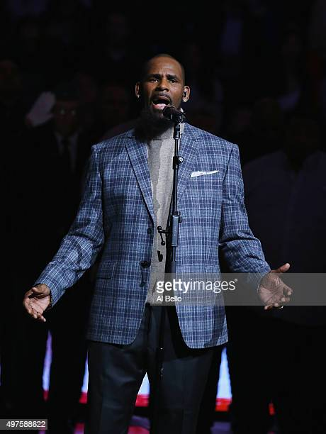 Singer R Kelly sings the National anthem before the Brooklyn Nets vs the Atlanta Hawks at The Barclays Center on November 17 2015 in New York City...