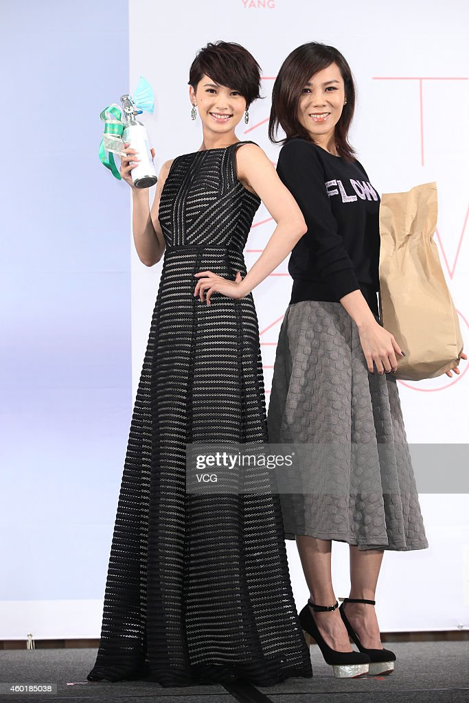 Singer <a gi-track='captionPersonalityLinkClicked' href=/galleries/search?phrase=Rainie+Yang&family=editorial&specificpeople=574307 ng-click='$event.stopPropagation()'>Rainie Yang</a> (L) and singer Tanya Chua attend press conference for <a gi-track='captionPersonalityLinkClicked' href=/galleries/search?phrase=Rainie+Yang&family=editorial&specificpeople=574307 ng-click='$event.stopPropagation()'>Rainie Yang</a>'s new album 'A Tale Of Two Rainie' on December 9, 2014 in Taipei, Taiwan.