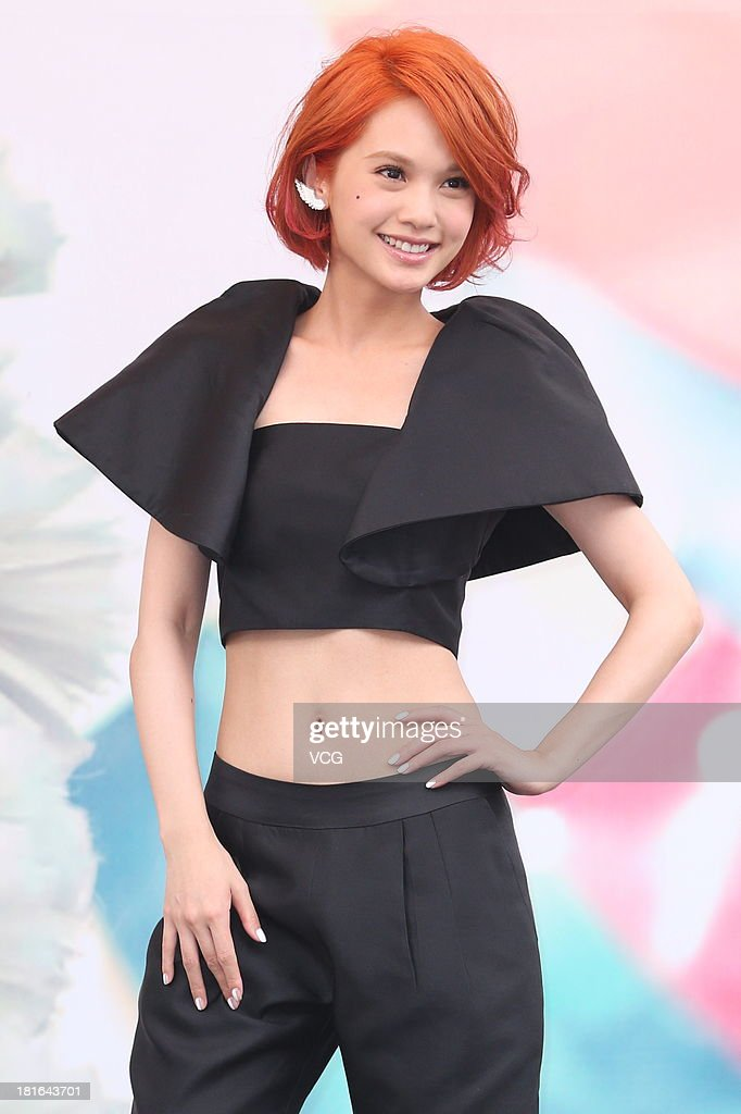 Singer <a gi-track='captionPersonalityLinkClicked' href=/galleries/search?phrase=Rainie+Yang&family=editorial&specificpeople=574307 ng-click='$event.stopPropagation()'>Rainie Yang</a> attends a press conference to promote her album 'Angel Wings' at Ximending on September 22, 2013 in Taipei, Taiwan.
