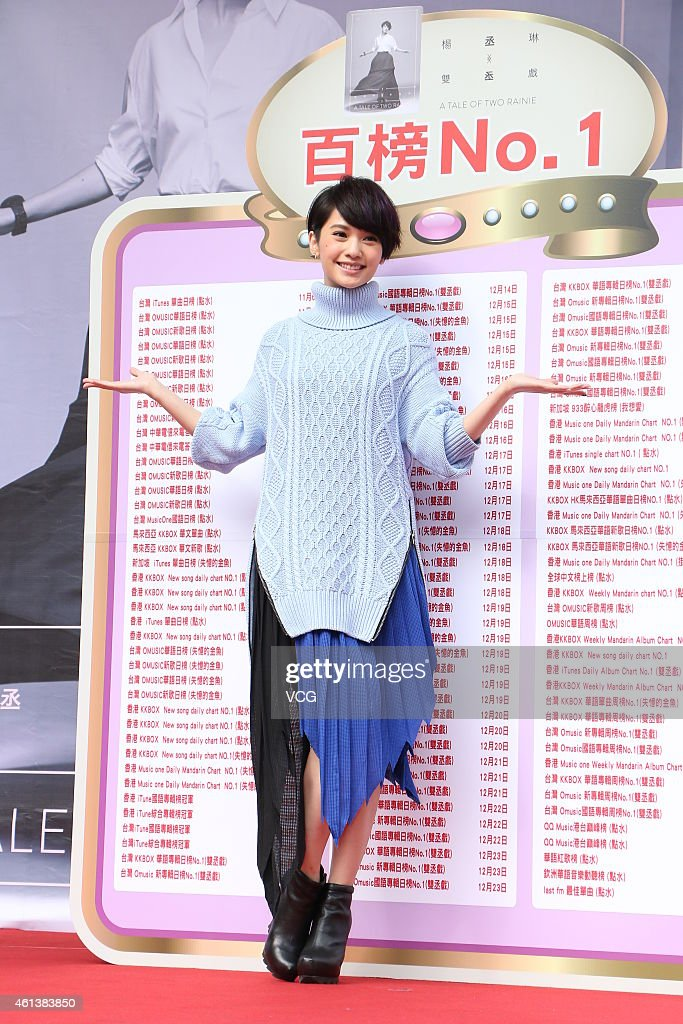 Singer <a gi-track='captionPersonalityLinkClicked' href=/galleries/search?phrase=Rainie+Yang&family=editorial&specificpeople=574307 ng-click='$event.stopPropagation()'>Rainie Yang</a> holds her new album 'A Tale of Two Rainie' autograph signing event on January 11, 2015 in Taipei, Taiwan of China.