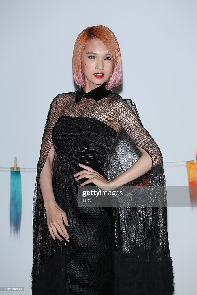 Singer <a gi-track='captionPersonalityLinkClicked' href=/galleries/search?phrase=Rainie+Yang&family=editorial&specificpeople=574307 ng-click='$event.stopPropagation()'>Rainie Yang</a> shoots micro film for Zoom Hair on Monday August 19,2013 in Taipei,China.