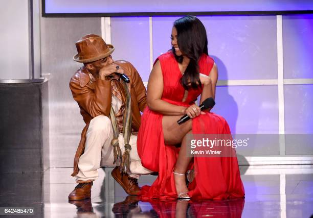 Singer Ralph Tresvant performs onstage with host Regina Hall during BET Presents the American Black Film Festival Honors on February 17 2017 in...