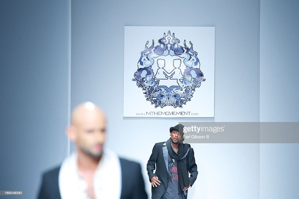 Singer Ralph Tresvant shows off the latest designs by designer Michael Herrera during LA Fashion Week on October 17, 2013 in Los Angeles, California.