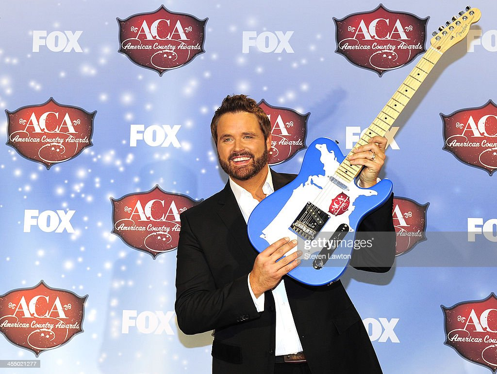Singer <a gi-track='captionPersonalityLinkClicked' href=/galleries/search?phrase=Randy+Houser&family=editorial&specificpeople=5348597 ng-click='$event.stopPropagation()'>Randy Houser</a> poses in th press room during the American Country Awards 2013 at the Mandalay Bay Events Center on December 10, 2013 in Las Vegas, Nevada.