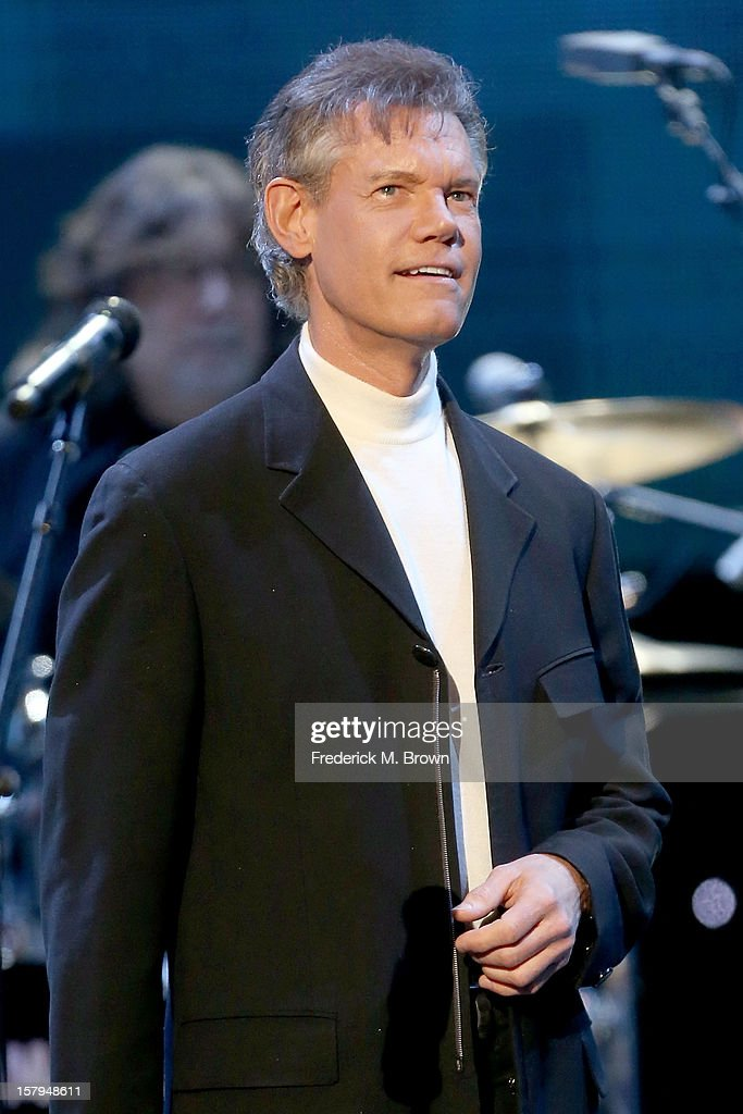 Singer <a gi-track='captionPersonalityLinkClicked' href=/galleries/search?phrase=Randy+Travis&family=editorial&specificpeople=208114 ng-click='$event.stopPropagation()'>Randy Travis</a> onstage at the American Giving Awards presented by Chase held at the Pasadena Civic Auditorium on December 7, 2012 in Pasadena, California.