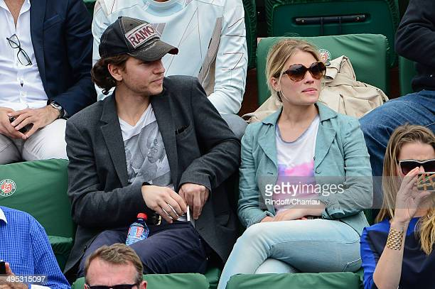 Singer Raphael and his companion actress Melanie Thierry attend the Roland Garros French Tennis Open 2014 on Day 9 at Roland Garros on June 2 2014 in...