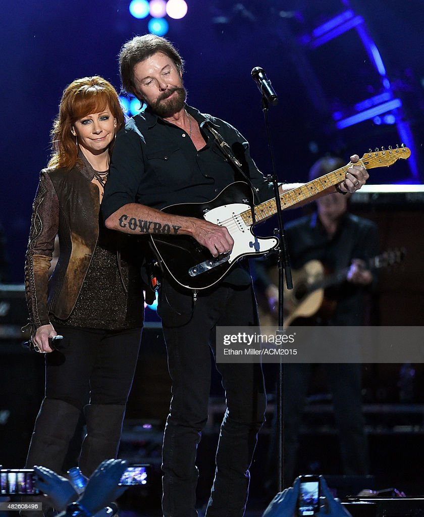 Singer Reba McEntire (L) and recording artist Ronnie Dunn of Brooks & Dunn perform during ACM Presents: Superstar Duets at Globe Life Park in Arlington on April 17, 2015 in Arlington, Texas.