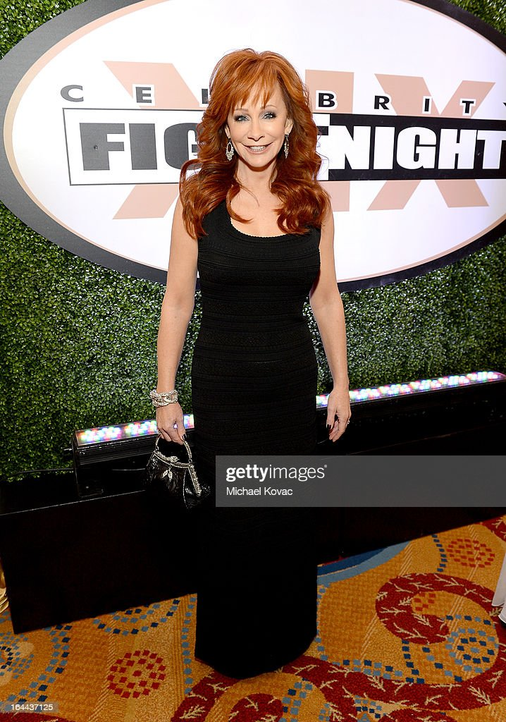 Singer Reba McEntire with Moet & Chandon at Celebrity Fight Night XIX at JW Marriott Desert Ridge Resort & Spa on March 23, 2013 in Phoenix, Arizona.