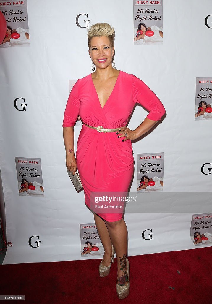 Singer <a gi-track='captionPersonalityLinkClicked' href=/galleries/search?phrase=Rebecca+Crews&family=editorial&specificpeople=569931 ng-click='$event.stopPropagation()'>Rebecca Crews</a> attends the release party for Niecy Nash new book 'It's Hard To Fight Naked' at the Luxe Rodeo Drive Hotel on May 14, 2013 in Beverly Hills, California.