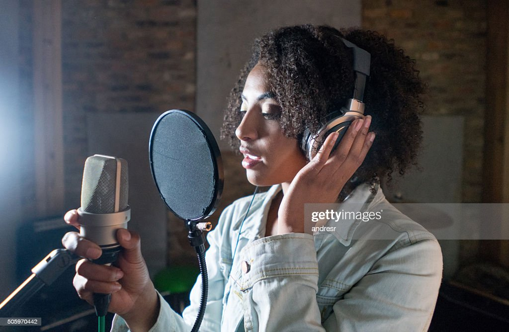 Singer recording in a music studio